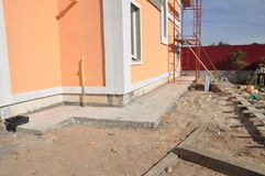 New house construction foundation waterproofing, damp proofing, insulation with contrete path to avoid water leaks for home wall. New home construction royalty free stock photo