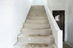 New house construction with concrete staircase. New house construction interior with concrete staircase at building site Stock Images