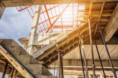 New house construction with concrete staircase. New house construction interior with concrete staircase at building site Royalty Free Stock Images
