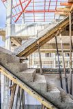 New house construction with concrete staircase. New house construction interior with concrete staircase at building site Stock Photos