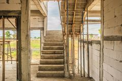 New house construction with concrete staircase. New house construction interior with concrete staircase at building site Royalty Free Stock Photos