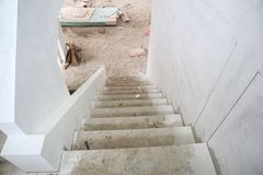 New house construction with concrete staircase at building site. New house construction interior with concrete staircase at building site Stock Image