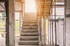 New house construction with concrete staircase. New house construction interior with concrete staircase at building site Royalty Free Stock Photo