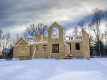 New house construction in winter. New house construction taking place in winter season Stock Photography