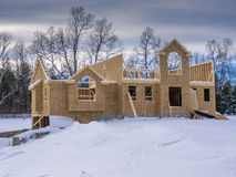 New house construction in winter. New house construction taking place in winter season Royalty Free Stock Image