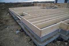 New house floor joist. Wood floor joist on top of basement foundation wall Royalty Free Stock Images
