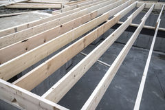 New house floor joist. Wooden house wall stud under construction Stock Image