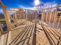 New house framing construction. New house framing with studs and flooring being put up Royalty Free Stock Image