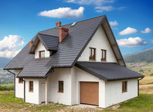 A new house with a garage in a rural area Stock Images