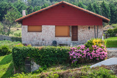 A new house with a garden in a rural area under beautiful sky Royalty Free Stock Images