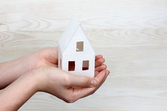 New house in human hands Royalty Free Stock Photos