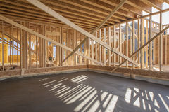 New house interior framing. With newly poured garage floor Royalty Free Stock Image