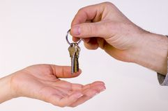 New house keys. Woman is receiving the keys for a new house Stock Photos