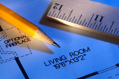 New House Layout Floor Plan with Pencil and Ruler. New house construction builder floor plan showing living room layout and dimensions with pencil and ruler Royalty Free Stock Images