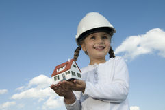 New house model. On girl hands Royalty Free Stock Images