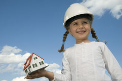 New house model. On girl hand Royalty Free Stock Image