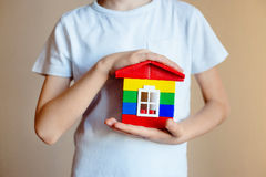 New house model concept in the hands of a child. building concept. bank loans. mortgage royalty free stock images