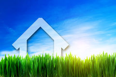 New house perspective on green sunny field Stock Images