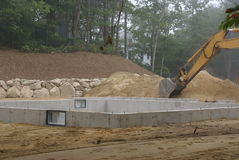 A new house poured concrete foundation after the forms are removed and concrete sealed. Royalty Free Stock Photos