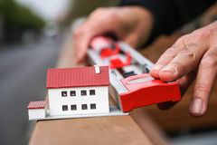 New house project. Scale model and measuring with a tubular spirit level stock photography