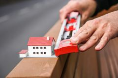 New house project. Scale model and measuring with a tubular spirit level royalty free stock images