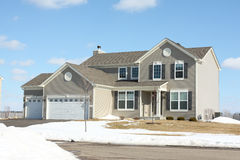 New house in the suburbs. A brand new suburban home in the winter Royalty Free Stock Photography