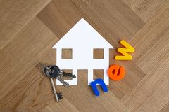 New house symbol with keys stock photography