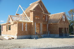 New House Under Construction. New home construction in a suburban subdivision royalty free stock image