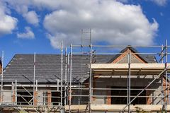 New house under construction in Cheshire England UK. New housing development with scaffold in Cheshire England United Kingdom Europe stock photos