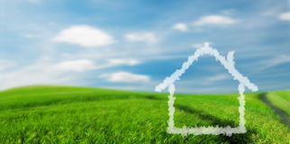 New house vision on the field. New house vision on green summer field with blue sky Royalty Free Stock Photos
