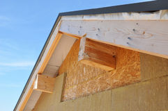 New house wall facade insulation against blue sky. Roof insulation detail. Stock Photography