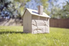 New house wrapped in brown paper royalty free stock images
