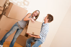 New house: Young couple moving box, unpacking Stock Photos