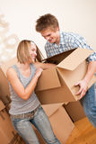 New house: Young couple moving box, unpacking Stock Photo
