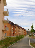 New houses. A road with just build and still constructed houses royalty free stock photography