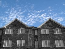 New Houses. Black And White against a beautiful sky.  London Style houses Royalty Free Stock Photography