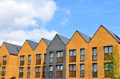 New houses. Property development concept with newly built houses against blue sky Royalty Free Stock Photos
