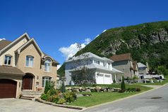 New houses in a rich area. New houses in a rich suburban neighborhood near the mountain Royalty Free Stock Image