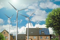 New houses with solar panels and wind generators Royalty Free Stock Photo