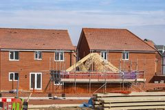 New houses under construction in Cheshire UK. New homes development with materials in Cheshire England United Kingdom Europe royalty free stock photo