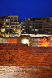 New housing and ancient ruins night scene Stock Photos