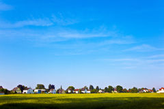 New housing area near the meadow in beautiful landscape Royalty Free Stock Images