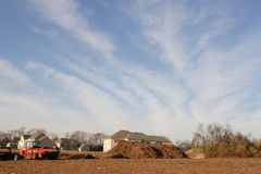 New housing development. A new housing development in NJ built near a farm with a large mulch pile and tractor Stock Photos