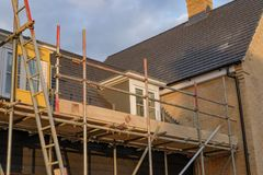New housing development showing scaffholding and safety neeting. Royalty Free Stock Image