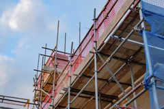 New housing development showing scaffholding and safety neeting. Royalty Free Stock Images