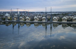 New housing developments reflected in Docklands Stock Photography