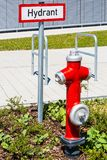 Hydrant. New hydrant on landscaped green space Stock Image