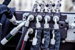 Hydraulic hoses connected at shallow depth of field stock images