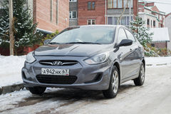 New Hyundai Solaris Accent parked in winter street. Stock Photos