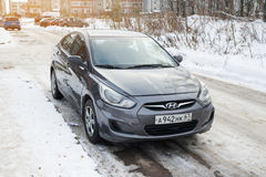 New Hyundai Solaris Accent parked in winter street. Royalty Free Stock Image